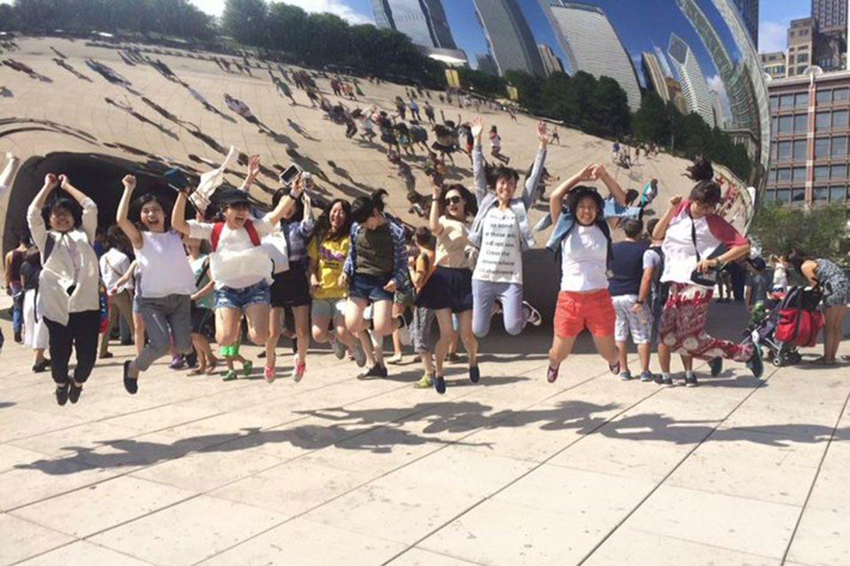 Visitors enjoying the Bean in Millenium Park