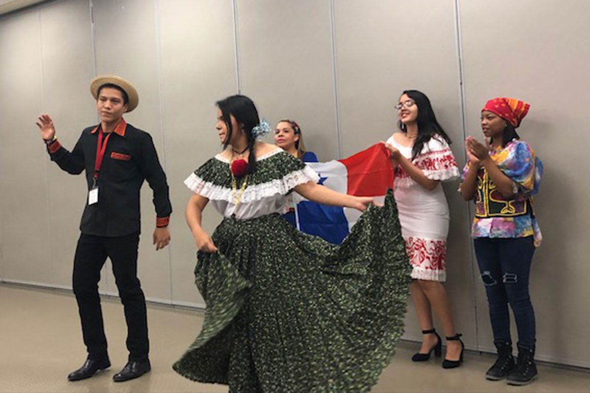 Youth visitors perform in traditional clothing from their home countries